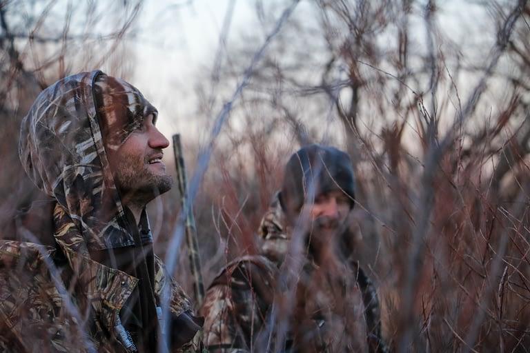 people hunting hogs