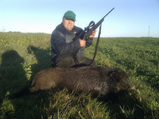 Lucky hunter with a hog